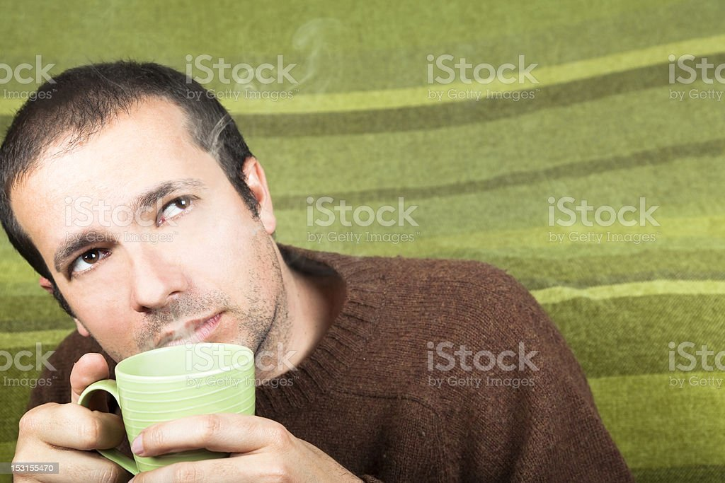 Man has a Hot Drink . Tea or Coffee. royalty-free stock photo