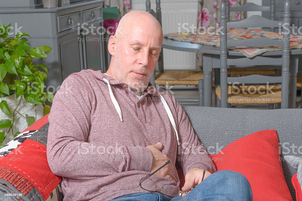 man has a stomach ache stock photo