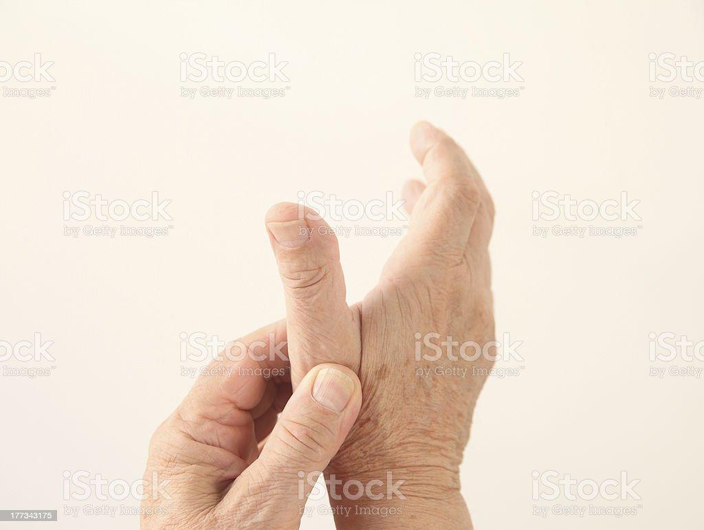 man has an aching thumb stock photo