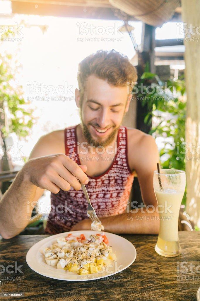 Man has breakfast stock photo
