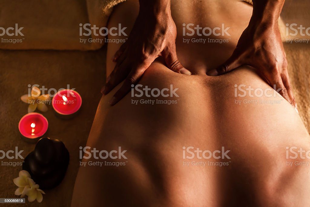 Man has deep tissue massage on the back. stock photo