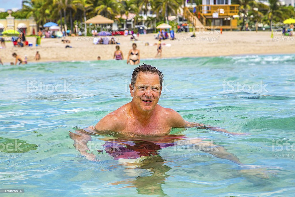 man has fun swimming in the ocean royalty-free stock photo