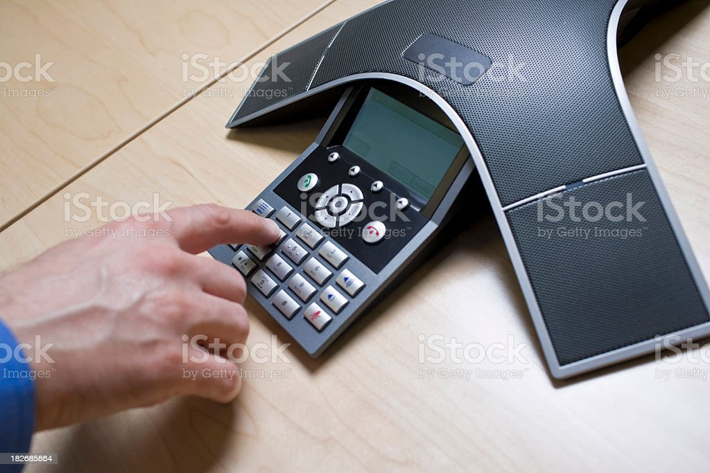 Man has meeting on a Conference Call phone stock photo