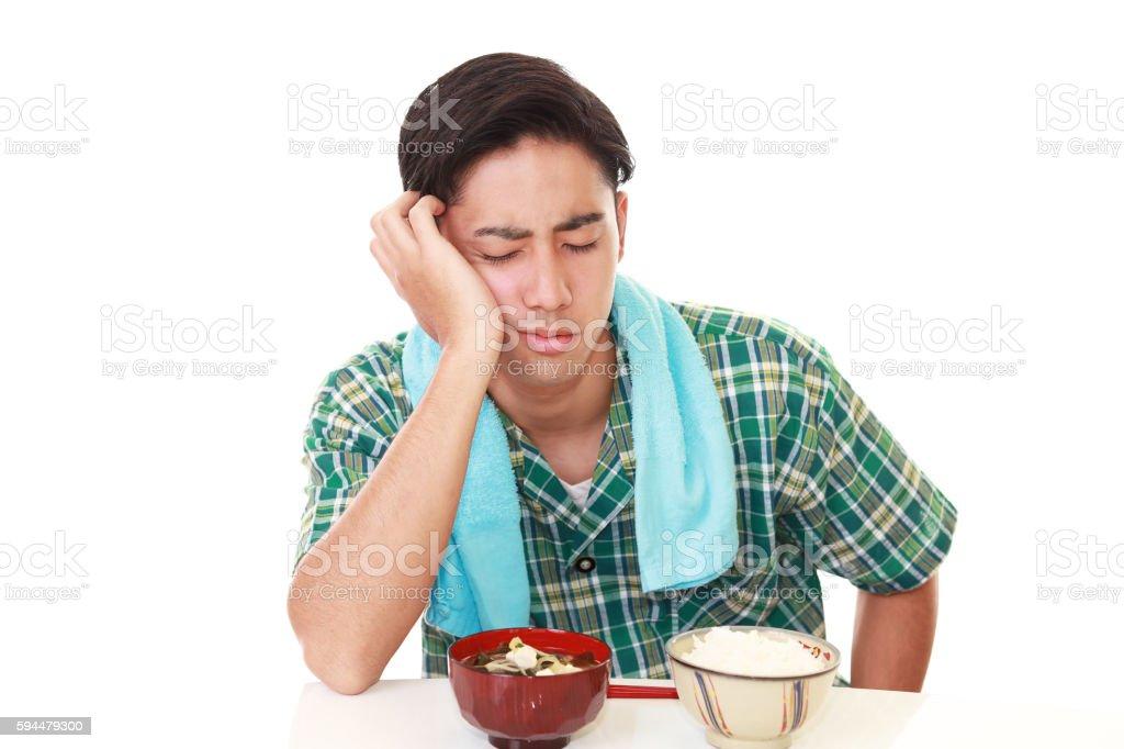Man has no appetite stock photo