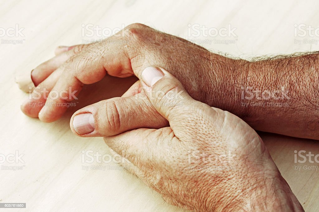 man has pain in his hand stock photo