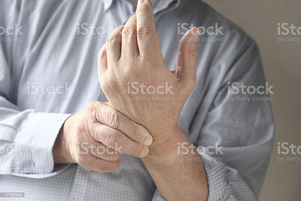 man has pain in wrist stock photo