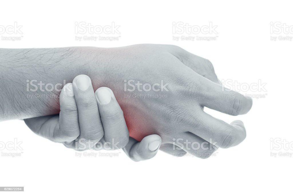 Man has pain in wrist stock photo