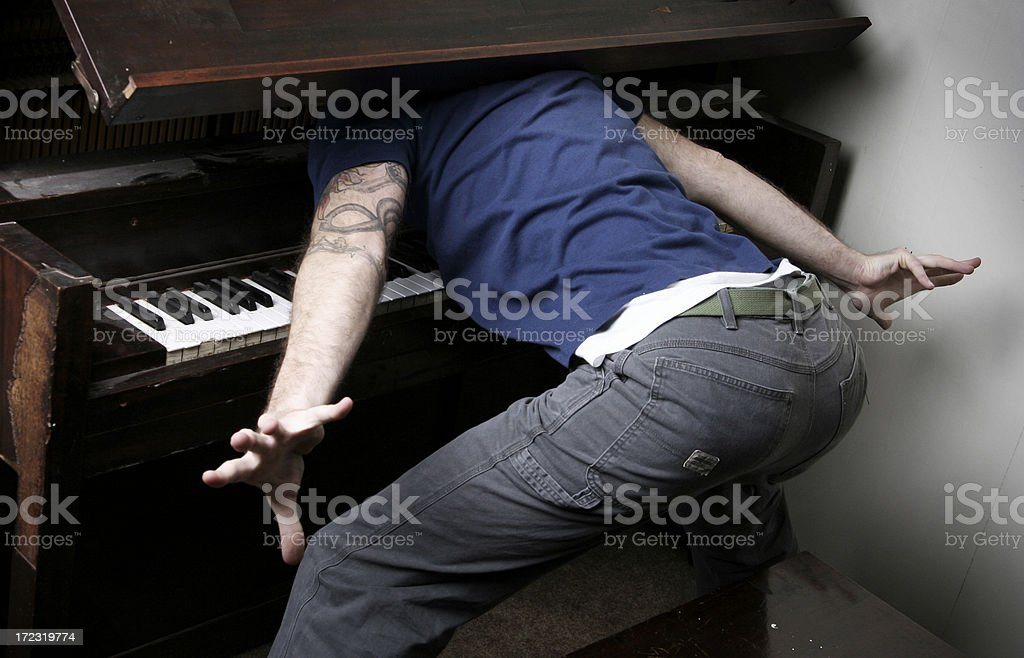 Man Has Painful Accident / Injury With A Piano royalty-free stock photo