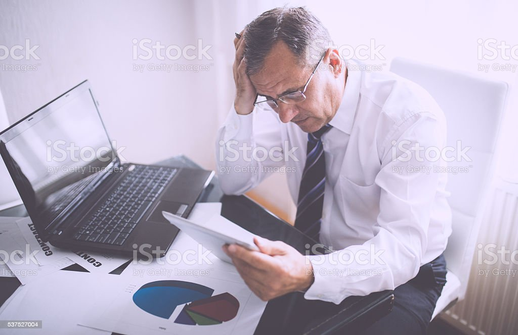 Man has problems at the office stock photo