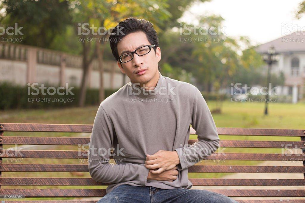 Man has stomach ache stock photo