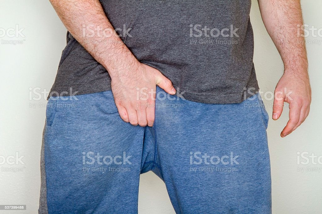Man has the itch stock photo