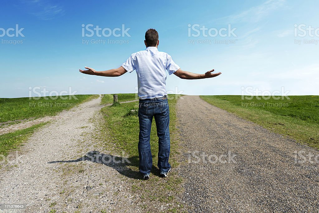 Man has to choose the right path royalty-free stock photo