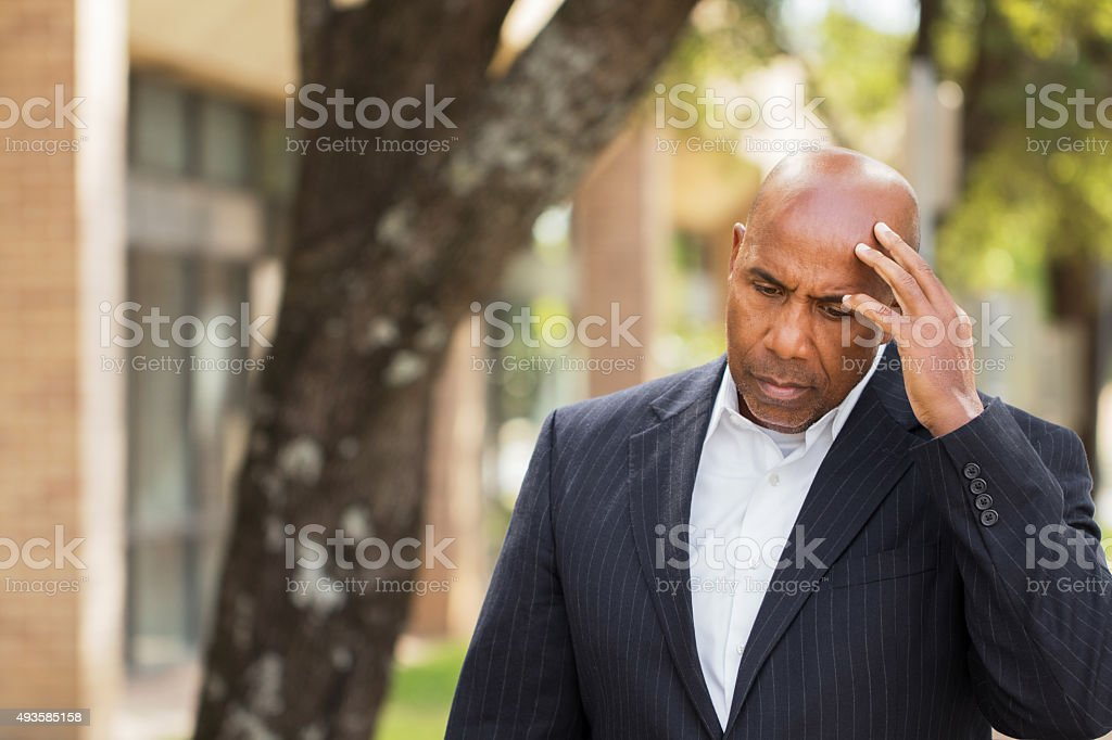 Man having a bad day at work. stock photo