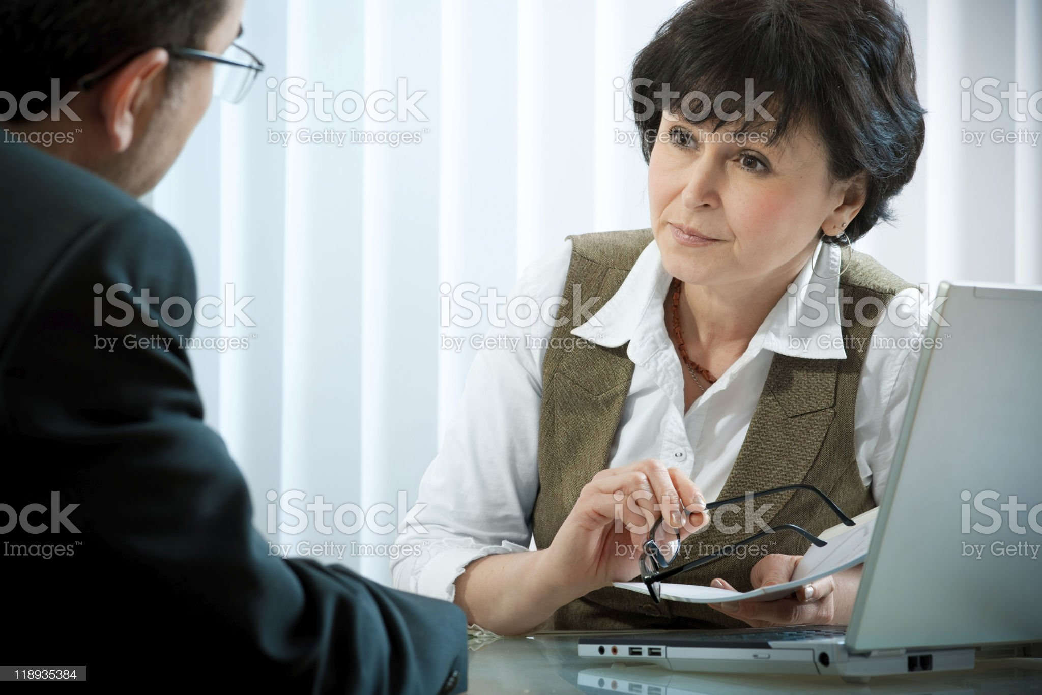 Man having a conversation with a woman royalty-free stock photo