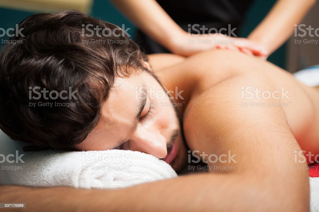 Man having a massage stock photo
