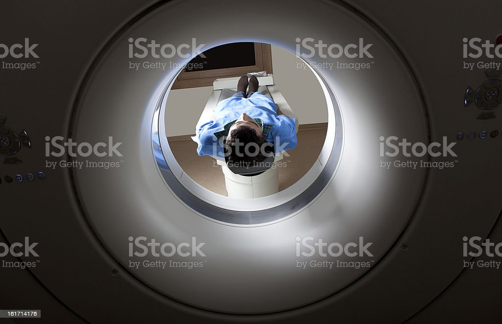 Young man in blue protective hospital clothes having medical...