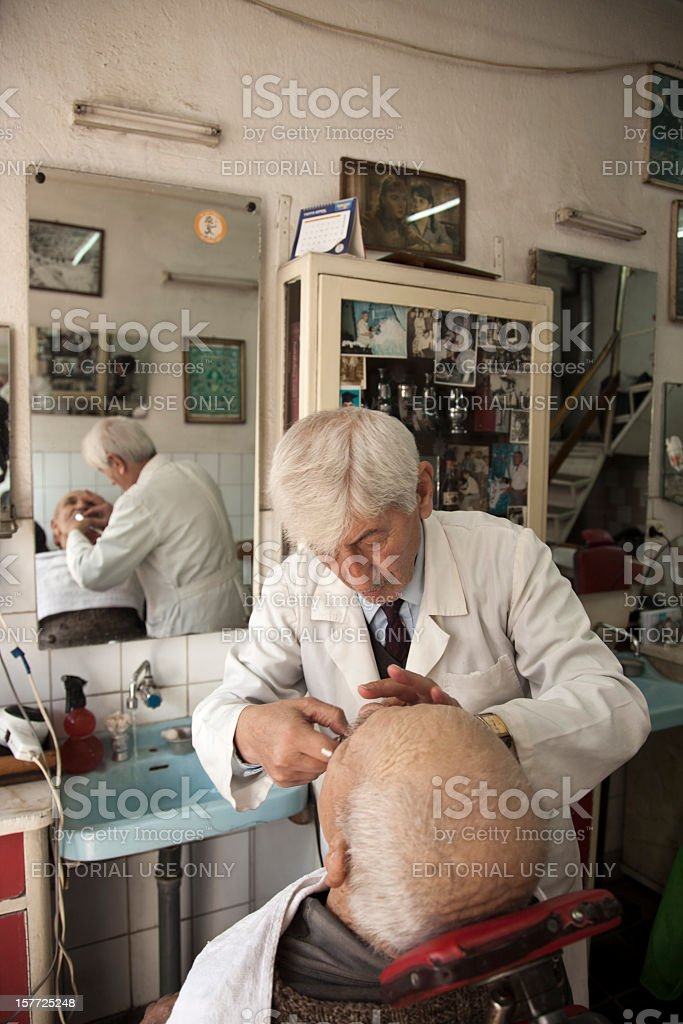 man having a shave at the barber shop royalty-free stock photo