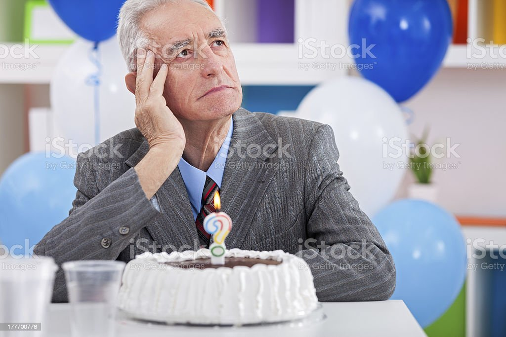 man having  Alzheimer's disease on birthday royalty-free stock photo