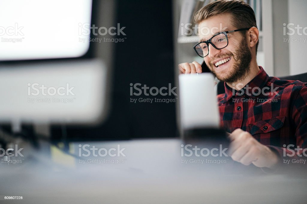 Man having an exciting call in the office stock photo