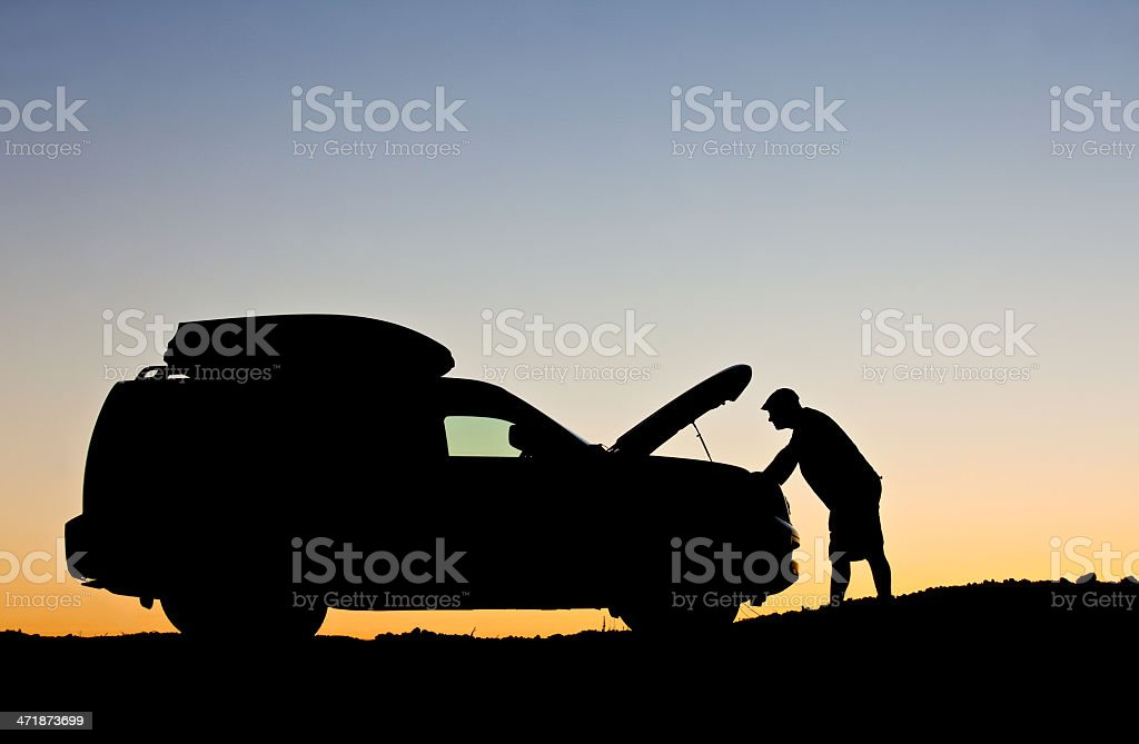 Man Having Car Trouble and Needing Roadside Assistance stock photo