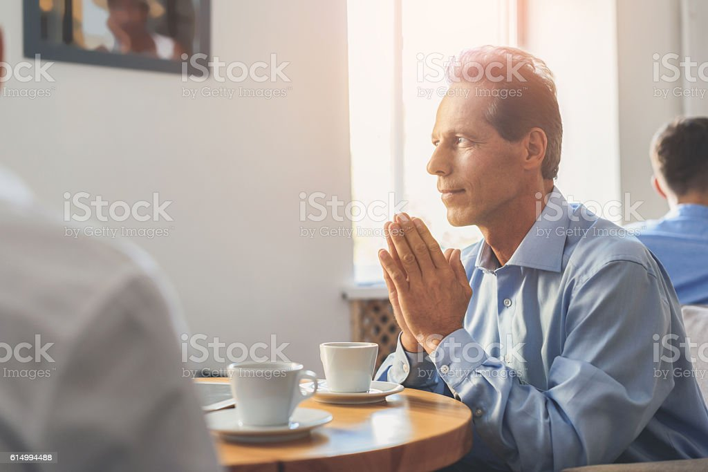 Man having coffee break in office stock photo