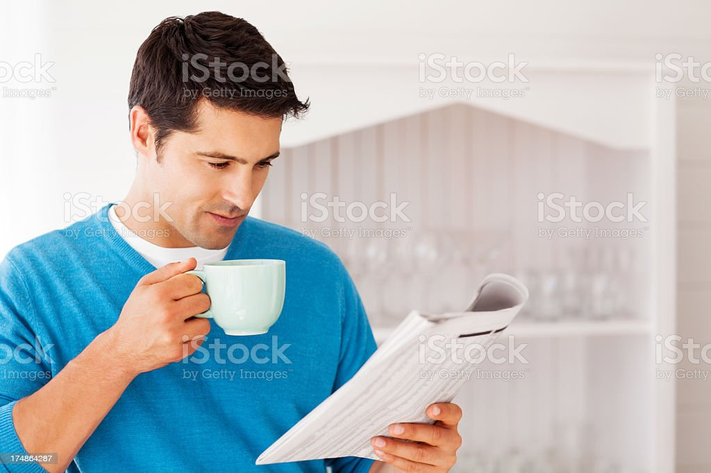 Man Having Coffee While Reading Newspaper royalty-free stock photo