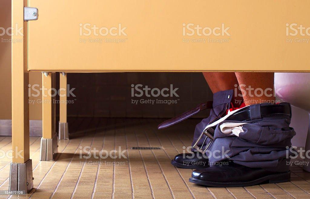 Man Having Diarrhea in the Bathroom Toilet stock photo