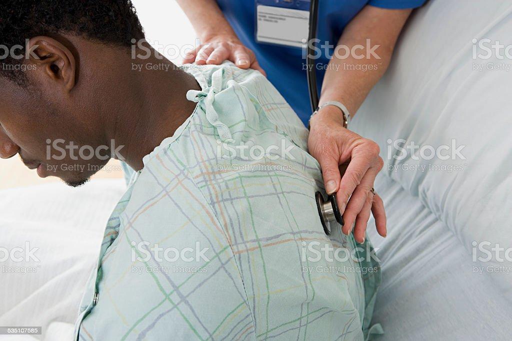 Man having examination in hospital stock photo