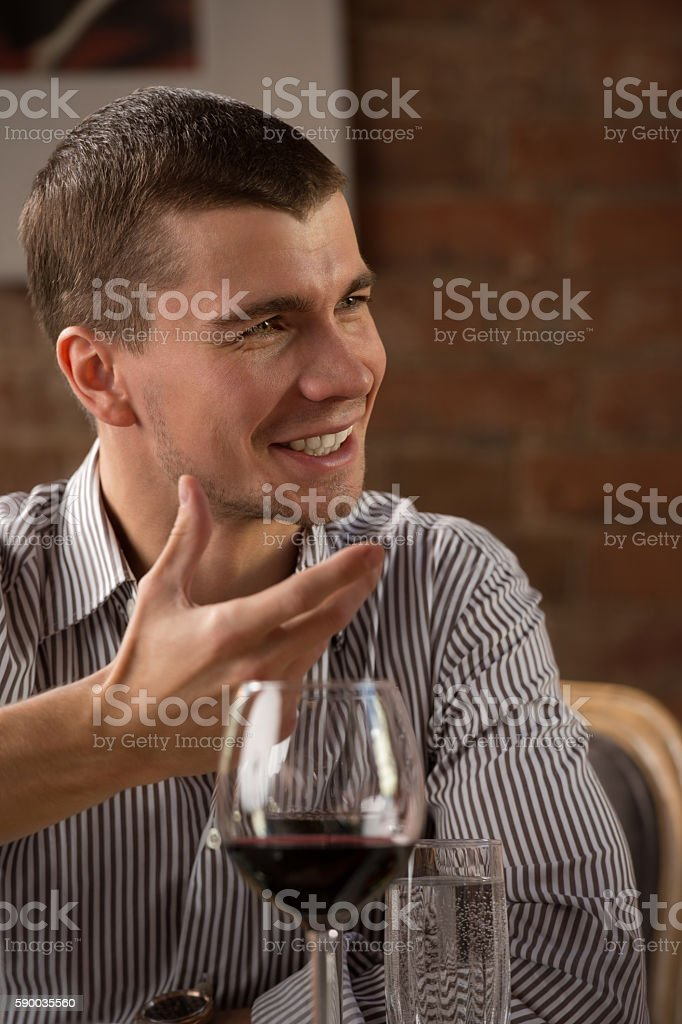 Man having fun at restaurant stock photo