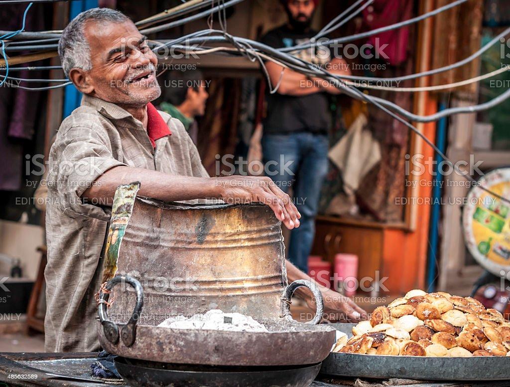 Man having fun at the Old Delhi street market stock photo