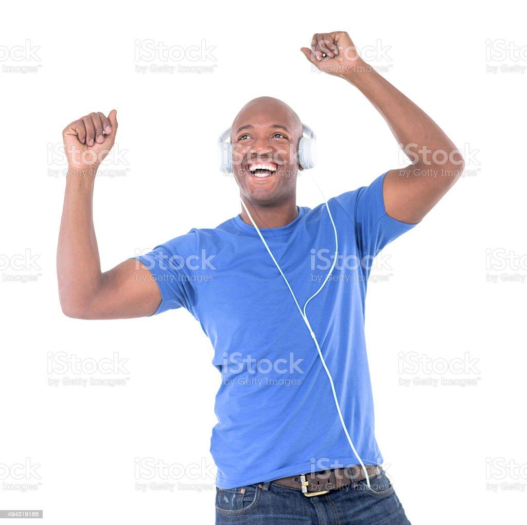 Man having fun listening to music and dancing stock photo