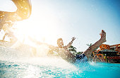 Man having fun on water slide.