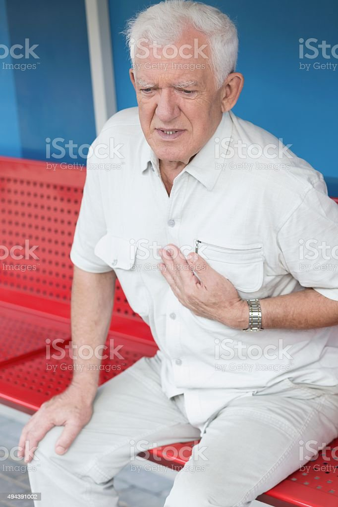 Man having heart attack stock photo