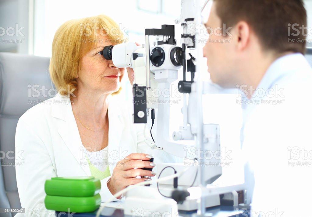 Man having his eyes examined. stock photo