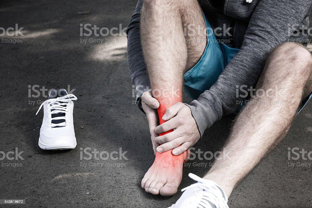 Man having leg injury stock photo