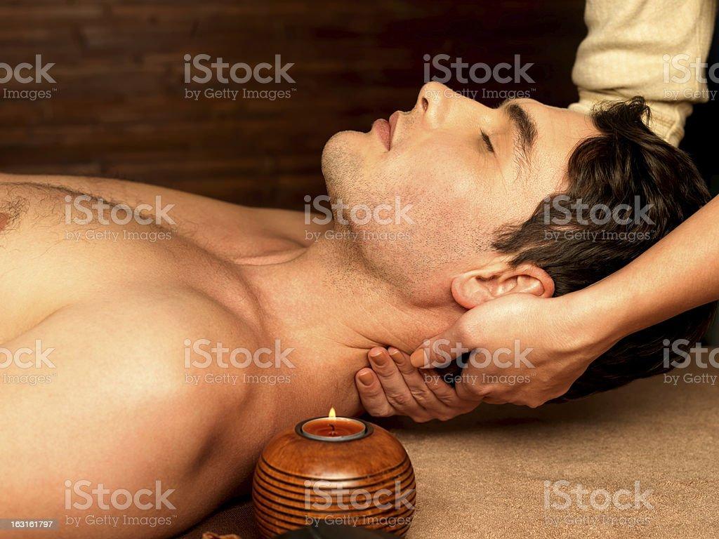 Man having neck massage in the spa salon royalty-free stock photo