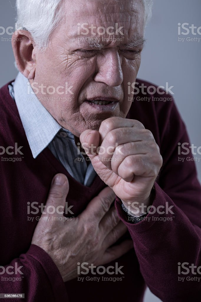 Man having pain in chest stock photo