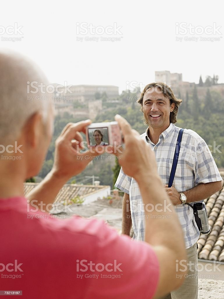 Man having photograph taken royalty-free stock photo