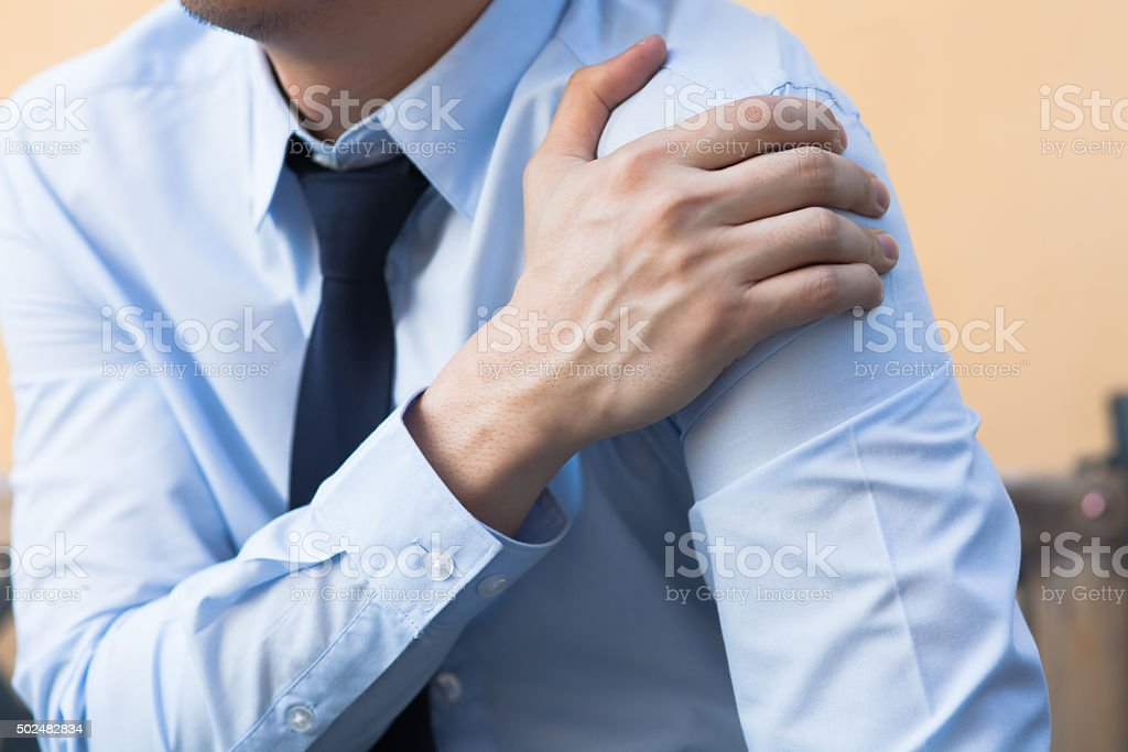 Man having shoulder pain problem stock photo
