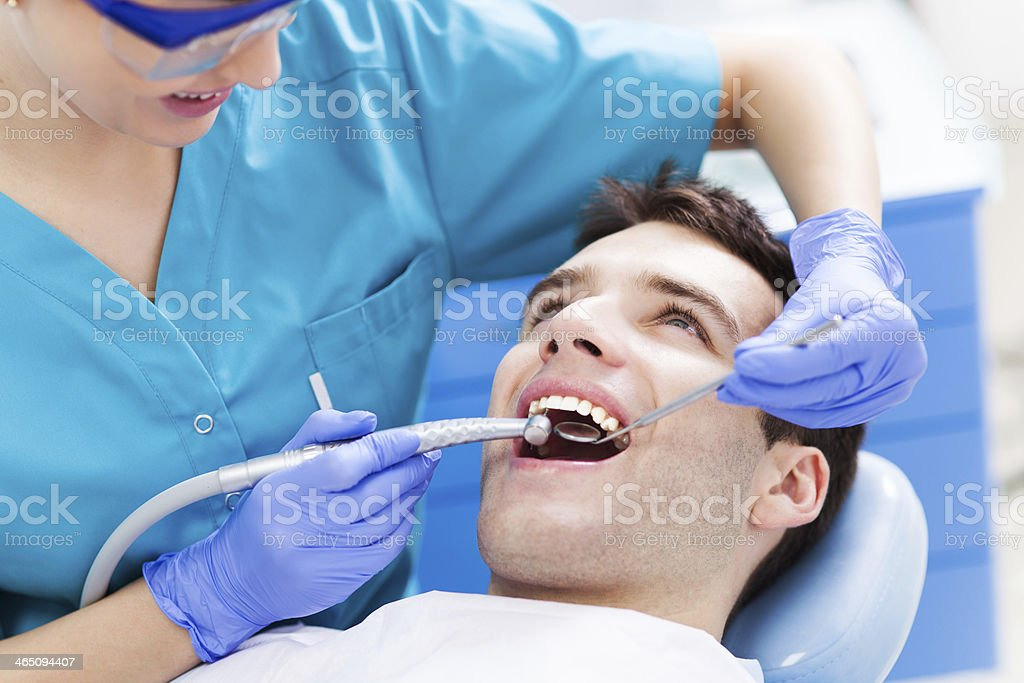 Man having teeth examined at dentists stock photo