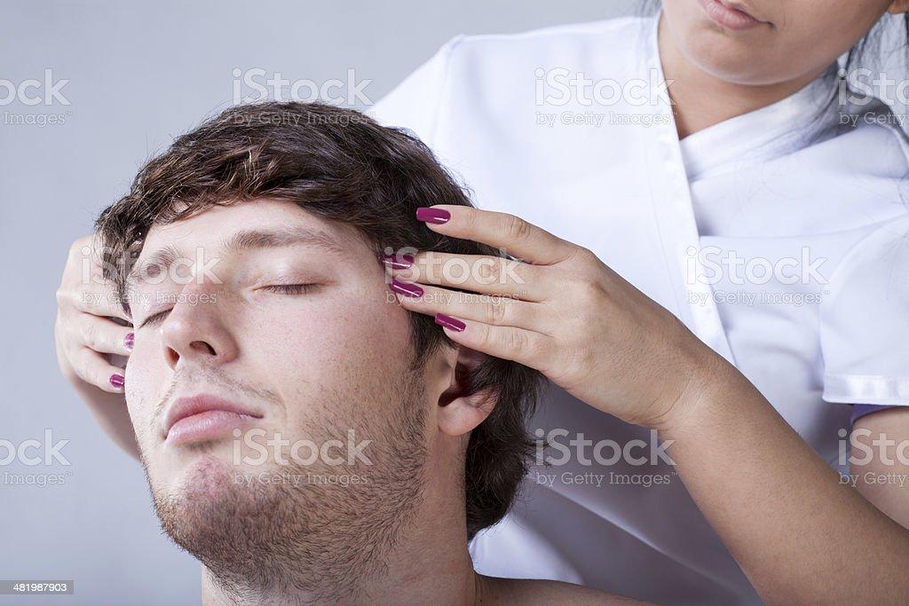 Man having temples massage stock photo