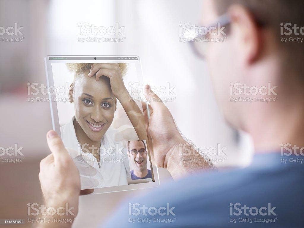 man having video call on the futuristic digital tablet royalty-free stock photo