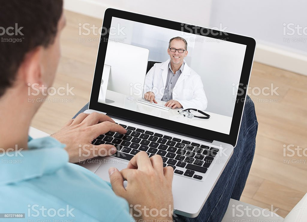 Man Having Video Chat With Doctor stock photo