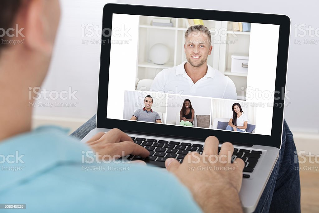 Man Having Video Conference With Friends stock photo