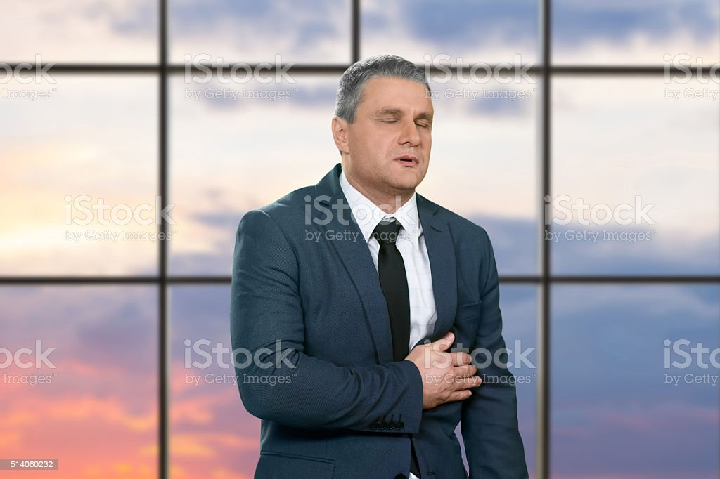Man heavily stressed at workplace. stock photo