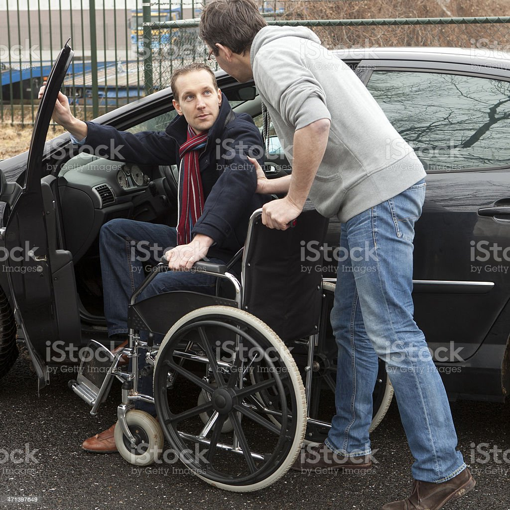 Man Helping a Disabled person stock photo