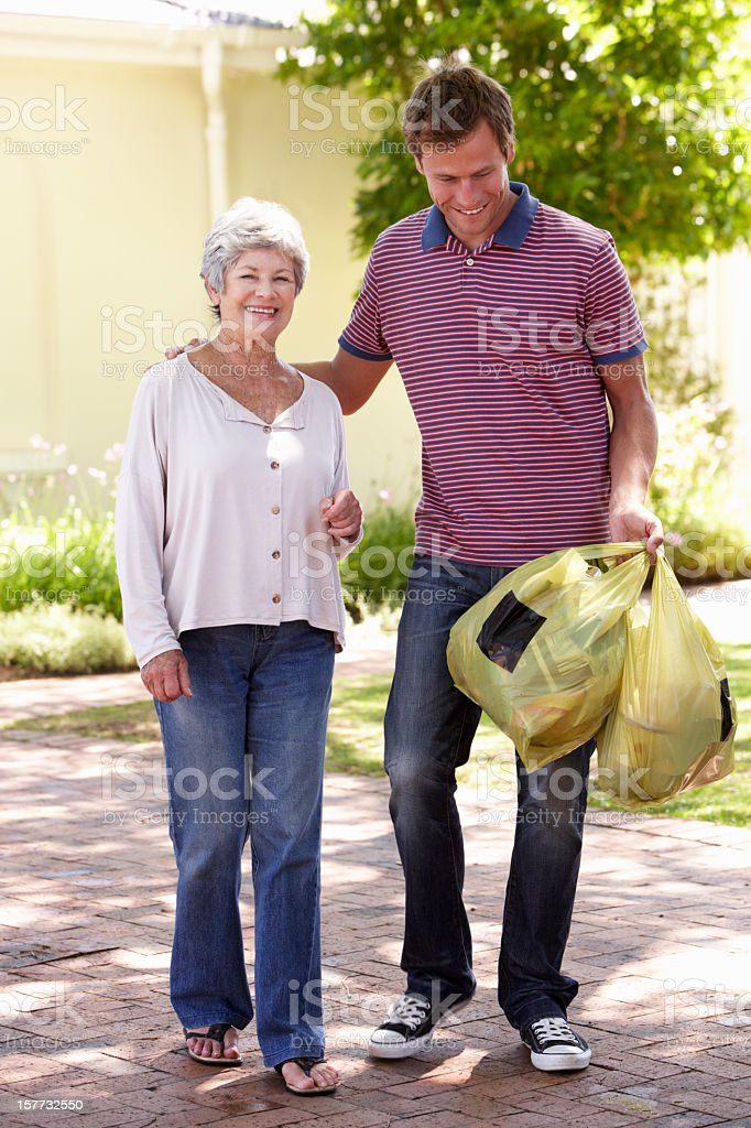 Man Helping Senior Woman With Shopping royalty-free stock photo