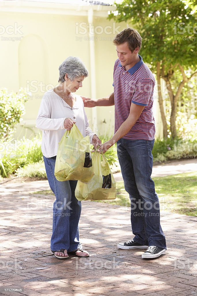 Man Helping Senior Woman With Shopping royalty-free stock photo
