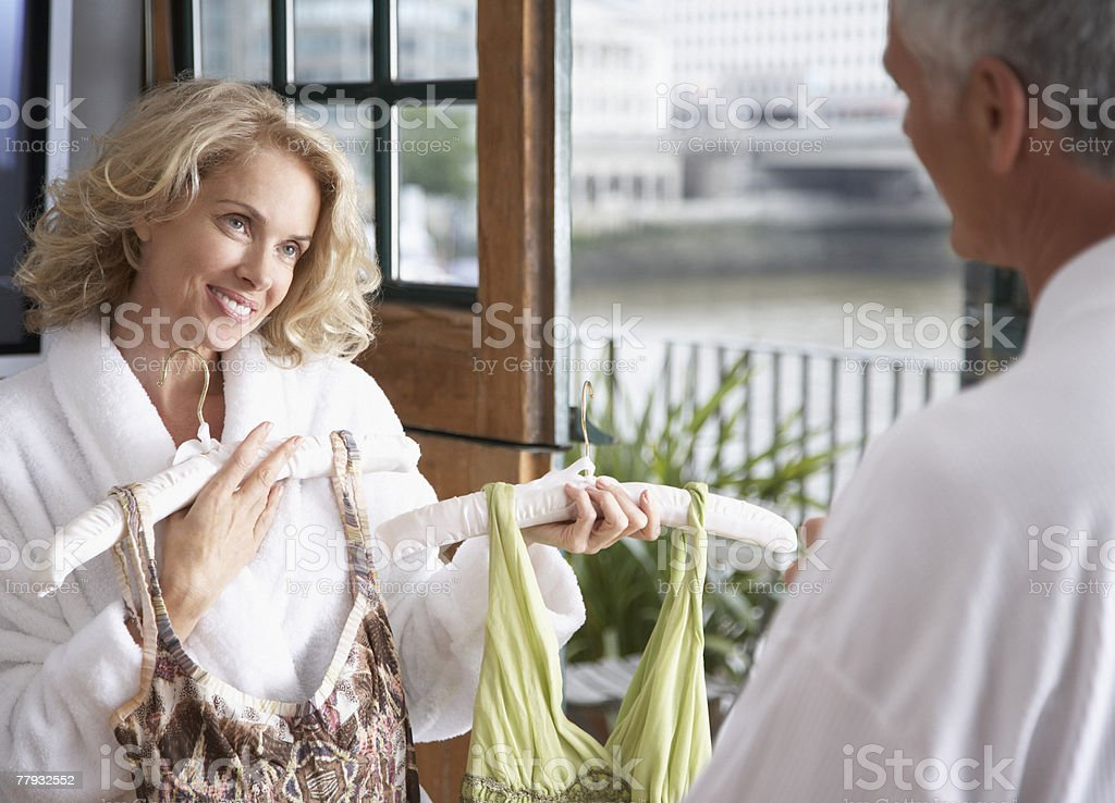 Man helping woman choose outfit royalty-free stock photo