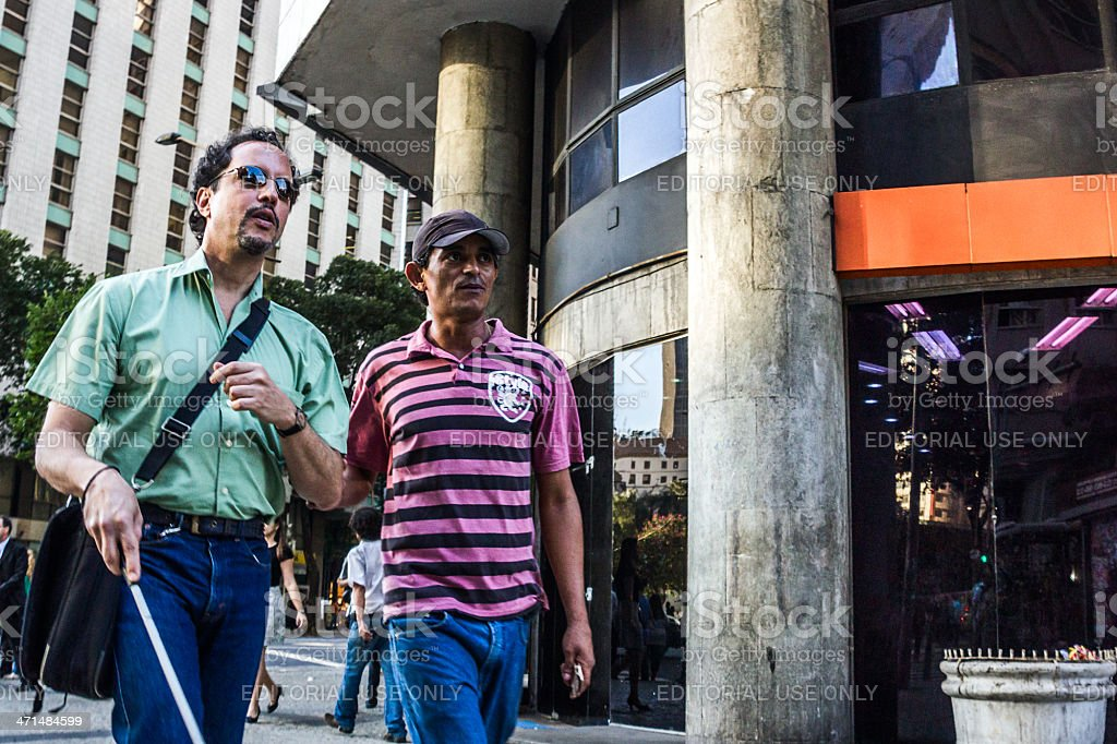 Man helps a blind guy stock photo
